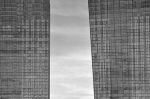 Category: Arch. Title: Two office towers. Black and white image of multi storey offices with mirrored windows, Singapore