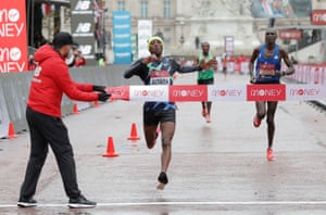Shura Kitata unexpectedly wins the men's race after the front-runners dropped the reigning champion and four-time winner Eliud Kipchoge with two laps to go.