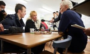 Philip Alston (right), the UN rapporteur on extreme poverty, meets users of a food bank in Newcastle
