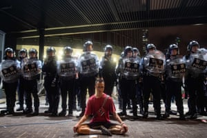 A protester surround by police