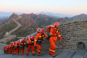 Chengde, China. Firefighters conduct fire protection patrols on the Great Wall of Jinshan Mountain