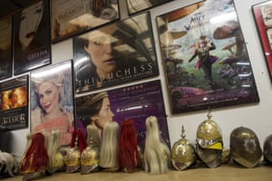 Wigs, hats and film posters on display