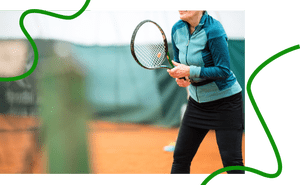 Older woman playing tennis