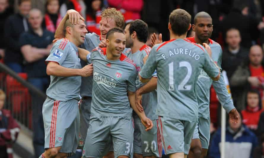 Andrea Dossena (left) is congratulated by his Liverpool teammates after sealing a 4-1 win at Manchester United.