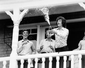England fast bowler Bob Willis of Warwickshire showers champagne from the dressing room balcony, watched by England captain Mike Brearley (left) and Tony Greig, after England's 7 wicket victory over Australia in the third Ashes Test at Trent Bridge in Nottingham in August 1977.