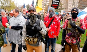 """Armed protesters provide security as demonstrators take part in an """"American Patriot Rally,"""" organized on 30 April."""
