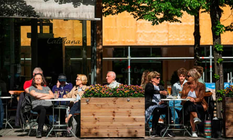 people sit in a Stockholm cafe in May