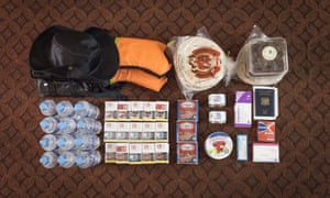 A Syrian refugee's belongings: bread, cigarettes, medicine, canned meat and cheese, dates, water and ID papers.