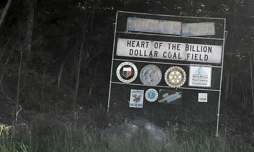 A faded sign welcomes drivers to Williamson, West Virginia.