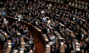 LDP MPs clap after the upper house of Japan's parliament approved security bills clearing the way for a policy shift that could allow troops to fight overseas for the first time since 1945.