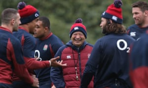 England's head coach Eddie Jones (centre) shares a joke with his players during a training session at Bagshot.