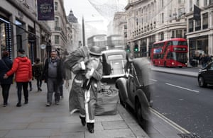 Father Christmas carries his sack of gifts through wartime London on 23 December 1940. He has exchanged his civilian red hood for a military-style tin hat as the blitz rocked the capital. Shoppers walk along Regent Street on 24 November 2017
