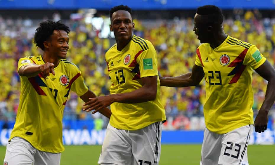 Colombia celebrate after Yerry Mina (centre) scored the only goal of the game against Senegal.