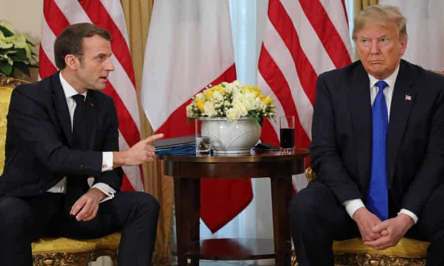 Outgoing US president Donald Trump meets the French president, Emmanuel Macron, in London in December last year.
