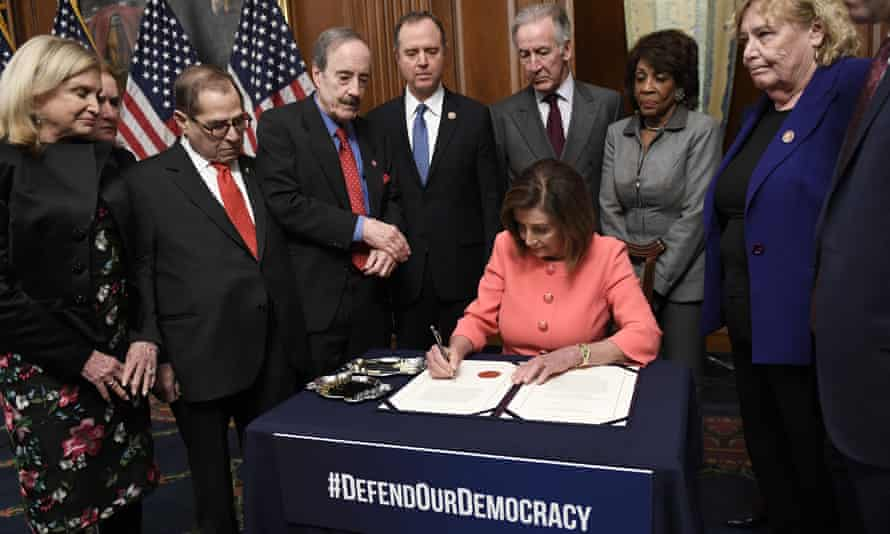 House speaker Nancy Pelosi signs the resolution to transmit the two articles of impeachment to the Senate for trial.