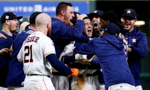 Alex Bregman celebrates with teammates after hitting a game-winning single to seal victory for the Astros