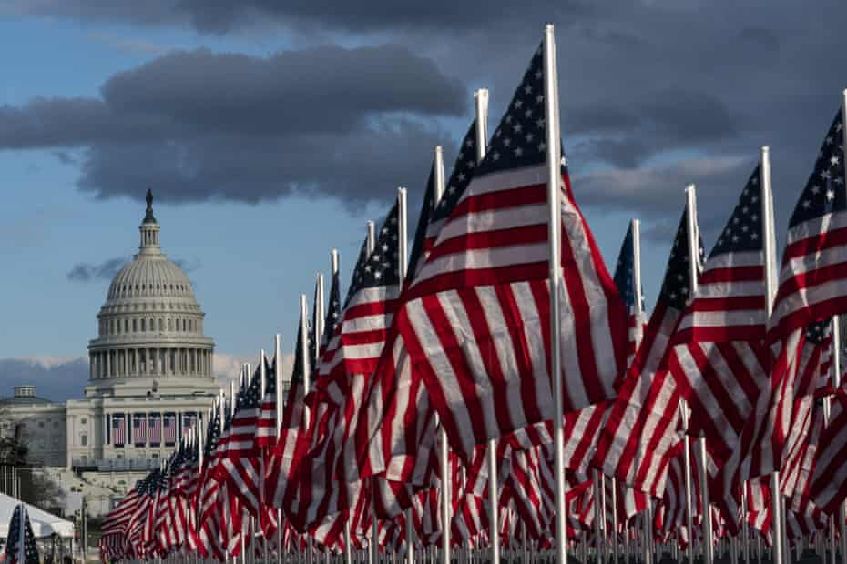 American flags are placed on the National Mall, with the US Capitol behind, ahead of the inauguration of President-elect Joe Biden and Vice President-elect Kamala Harris.