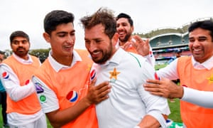 Yasir Shah is congratulated by his Pakistan teammates after scoring his century.