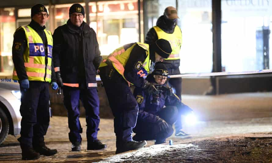 Police are seen in the area after several people were attacked in Vetlanda, Sweden, on 3 March.