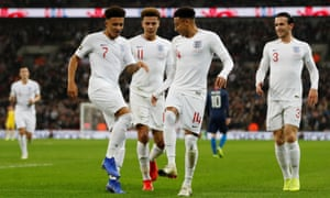 Jadon Sancho (left) and Jesse Lingard lead the celebrations after the Manchester United forward scored England's opener against USA.