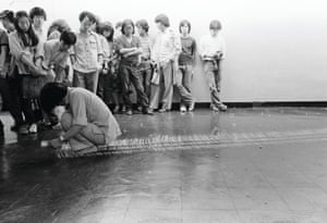 During this performance, the artist's body moves slowly one step after another, drawing his path in chalk on the floor. However, his actions are seemingly redundant – as one step is taken, the other step erases a previously drawn line