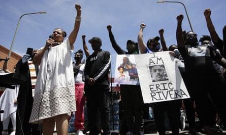 Melina Abdullah, left, of Black Lives Matter Los Angeles, leads a protest on 8 June.