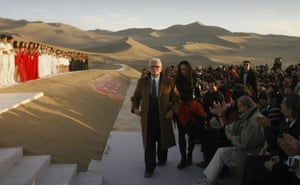Cardin stands after his fashion show in the desert of Whistling Sand Mountain desert in Gansu province, China, 2007