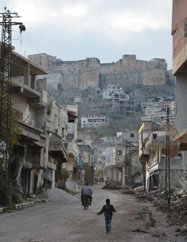 Al Hosn village beneath Krak des Chevaliers castle in rural Homs.