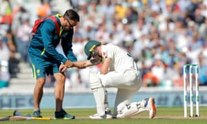Australia's Marnus Labuschagne receives treatment after being struck on the arm by a Jofra Archer delivery.