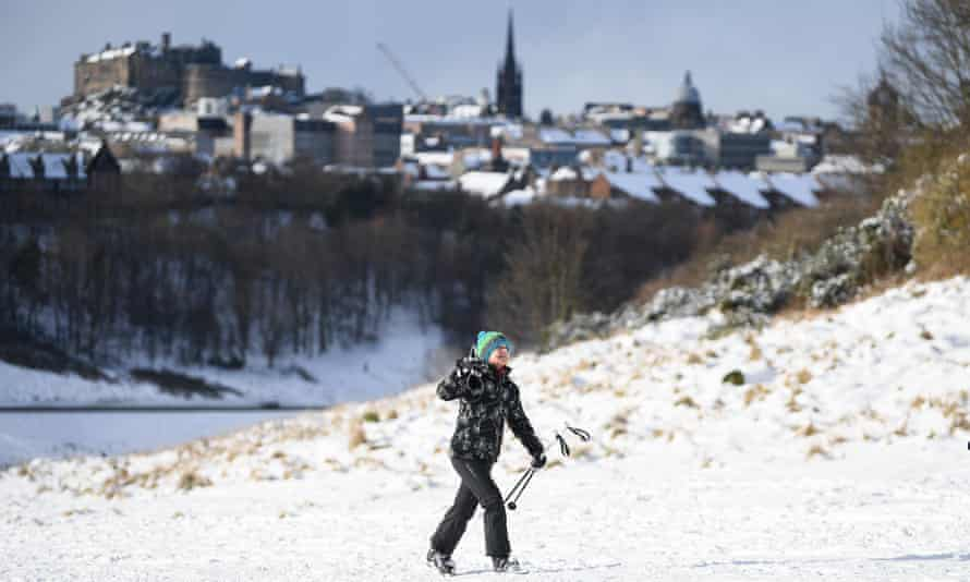 A person enjoys the snowy conditions in Edinburgh