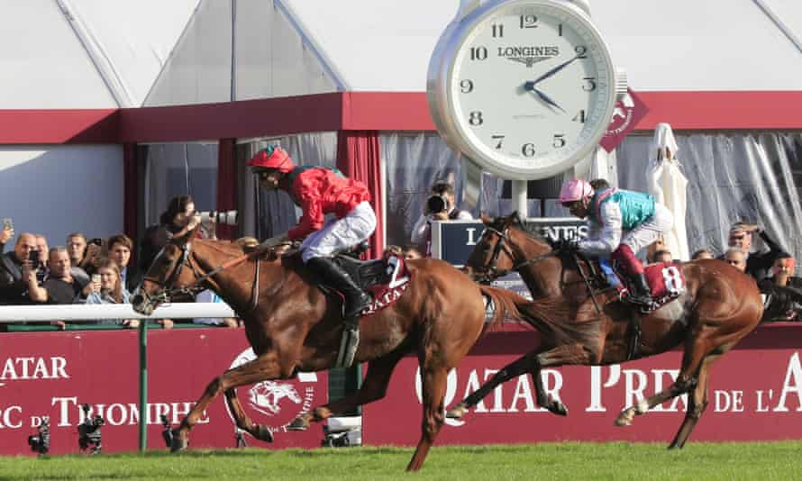 Waldgeist, left, passes Enable to take first place in the 2019 Prix de l'Arc de Triomphe.