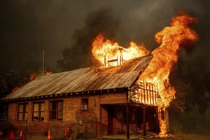 Shasta, California: A schoolhouse burns during a fire that destroyed multiple homes