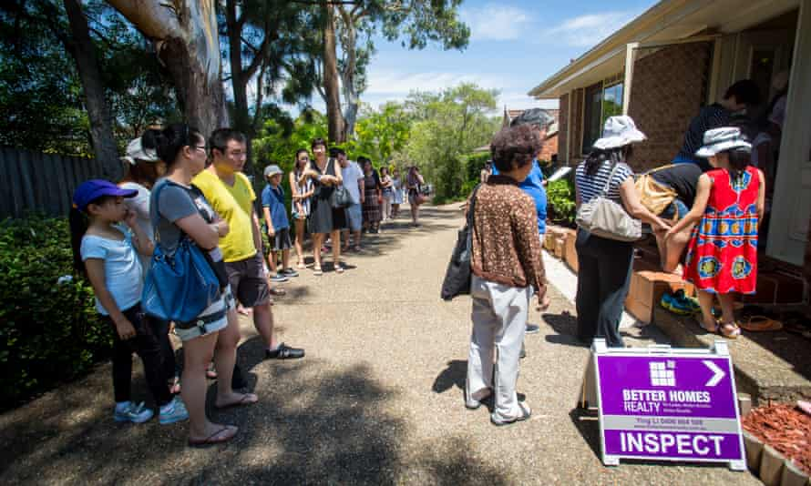 Prospective buyers wait in line to inspect a house for sale in the Sydney suburb of Eastwood