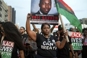 Activists with Black Lives Matter protest in the Harlem neighbourhood of New York in the wake of a decision by federal prosecutors who declined to bring civil rights charges against New York City police Officer Daniel Pantaleo in the 2014 chokehold death of Eric Garner.