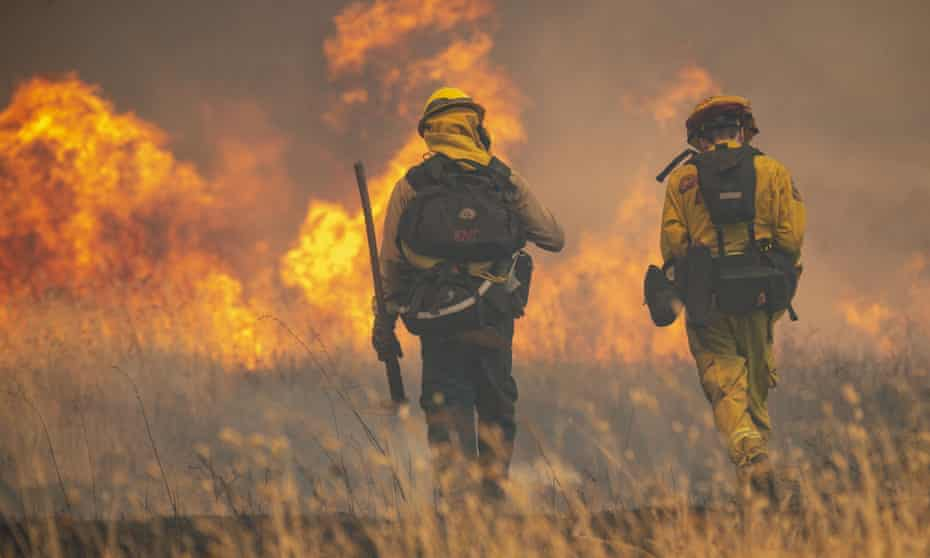 Firefighters with Cal Fire tackle spot fires near the town of Clearlake Oaks in northern California.