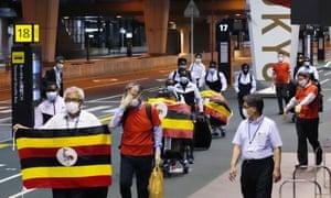 Members of Uganda's Olympic team prepare to leave for Osaka on Sunday, leaving behind one team member who has tested positive for coronavirus. Photograph: Sadayuki Goto/AP