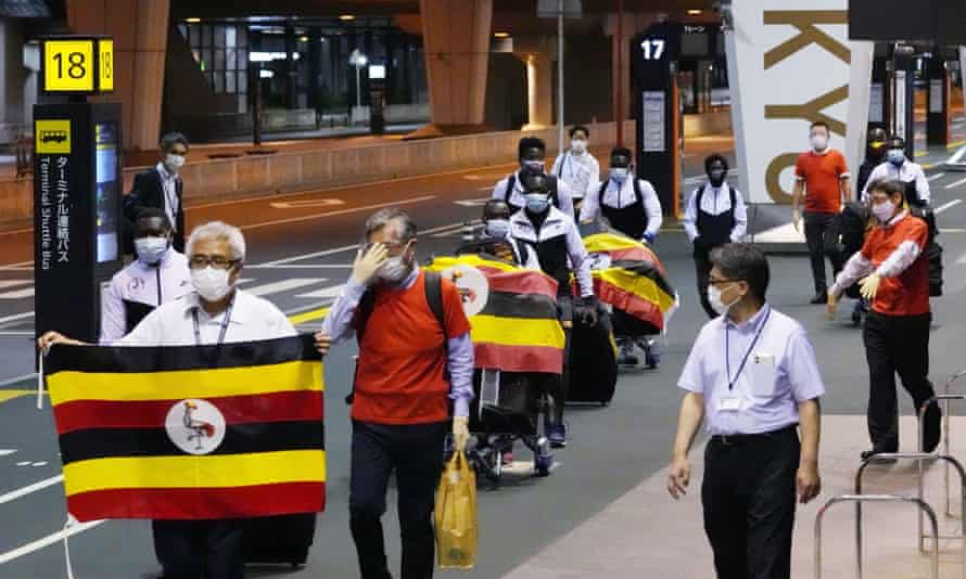 Members of Uganda's Olympic team prepare to leave for Osaka on Sunday, leaving behind one team member who has tested positive for coronavirus.
