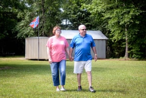 Lindy and Ira Isonhood walk along Deer Hollow, their property in Copiah County, Mississippi.