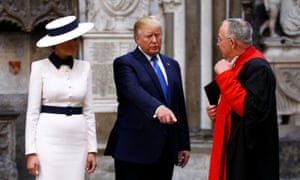 Donald Trump with Melania Trump and the Dean of Westminster, John Hall, in Westminster Abbey.