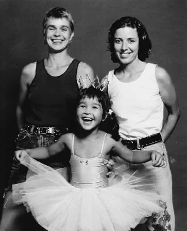 Maya Newell in 1993 with her two mothers, Liz Newell and Donna Ross.