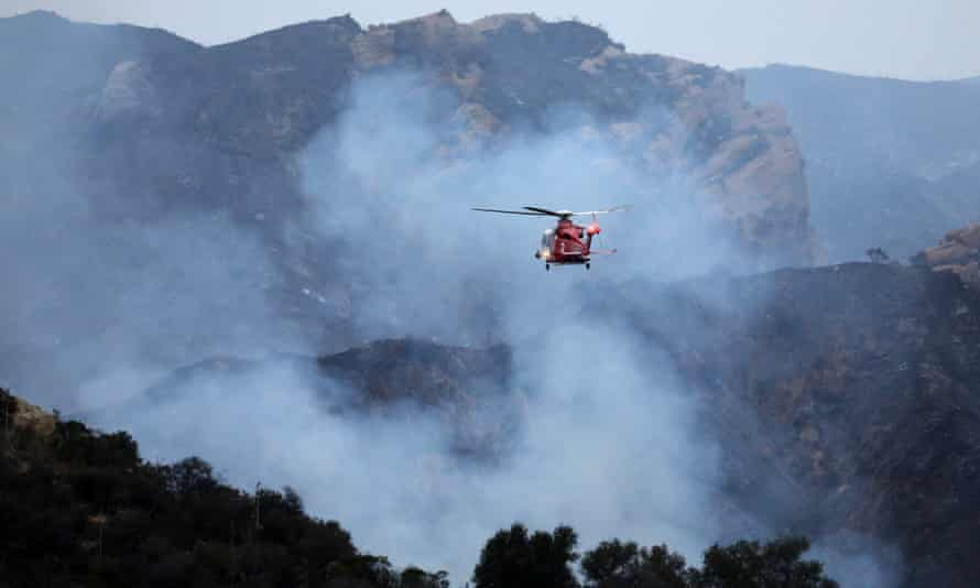 Firefighters continue to battle the Palisades fire in Los Angeles on 16 May.