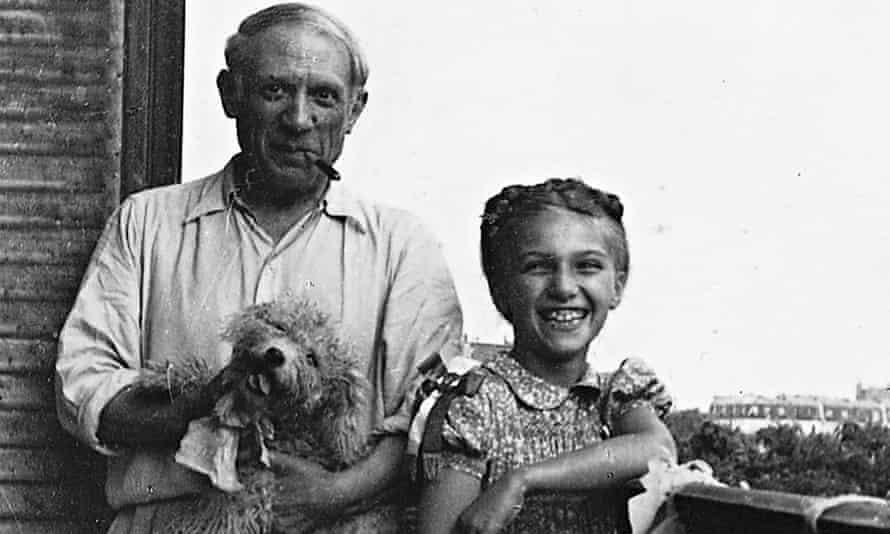 Pablo with their daughter, Maya, and dog, Ricky, in 1944. Photograph by Marie-Thérèse Walter © Maya Picasso collection.