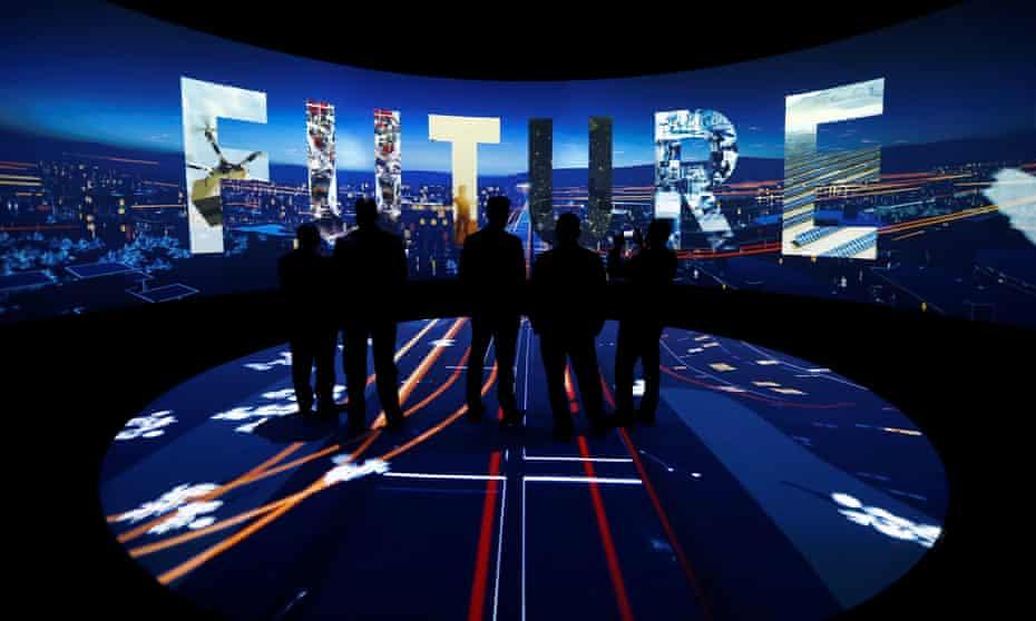 Visitors watch a 3D presentation at an exhibition on Neom held in Riyadh, Saudi Arabia
