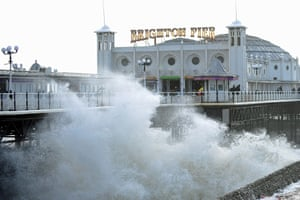 Historic Brighton Pier is hit by waves