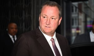 Mike Ashley leaving the Sports Direct headquarters in London