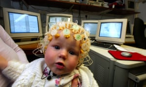 Catriona, four-months-old, with a Geodesic Sensornet on her head at the Baby Lab