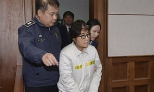 Choi Soon-sil appears for the first day of her trial at court in Seoul.