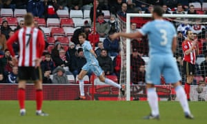 Stoke City's Peter Crouch wheels away in celebration after making it 3-0.