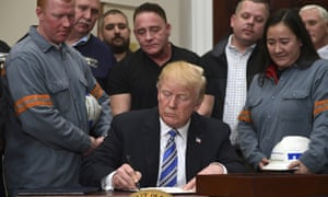 President Donald Trump signs a proclamation on steel imports