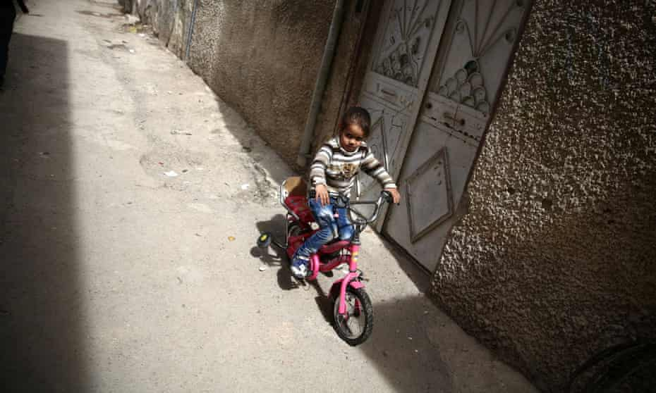 Syrian girl on a bicycle